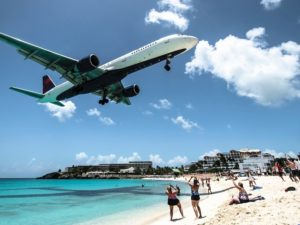 Close up view of the plane over the beach